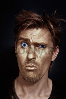Funny man with golden make-up