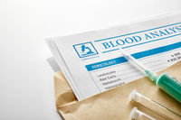 Blood test report in a brown envelope