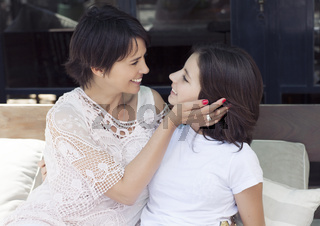 latin mother and daughter in outdoors