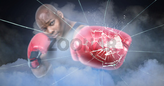 Composite image of fit man boxing with gloves