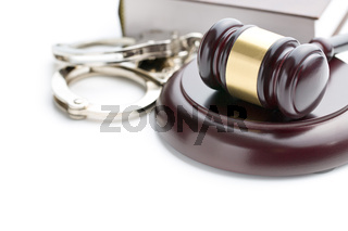 handcuffs and judge gavel