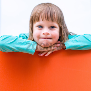 Girl child with orange board. Isolated portrait
