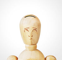 Man with the head as a money box. Abstract image with a wooden puppet