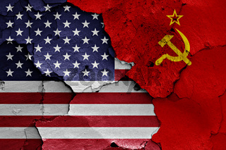 flags of USA and Soviet Union painted on cracked wall