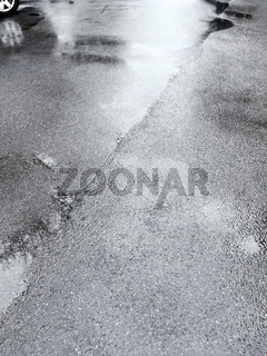 wet asphalt road after rain with reflections