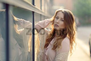 Beautiful woman in early morning sunlight