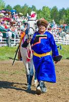Buryat Mongolian man with white horse