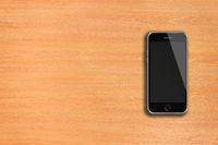 Mobile smart phone with black screen on wooden background.