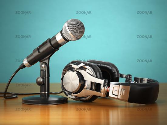 Microphone and headphones. Audio recording or radio commentator concept.