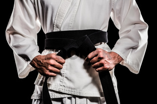 Fighter tightening karate belt