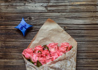 Wrapped bouquet of pink roses with Valentines gift