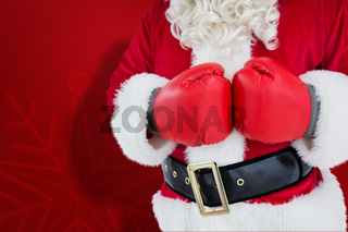 Composite image of mid section of santa with boxing gloves