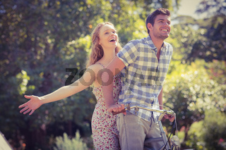 Cute couple on a bike ride in the park