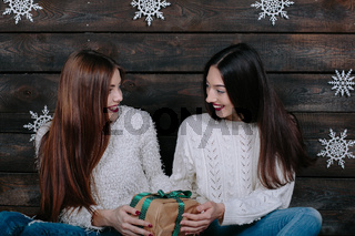 two beautiful girls together unpack gifts