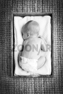 Newborn Baby In Crate Black and White
