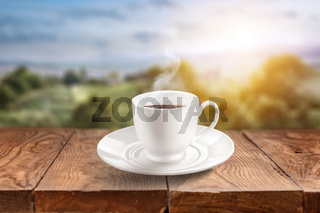Empty wooden table against green background