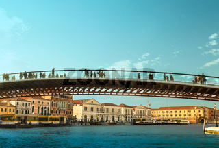 People crossing Grand Canal on Constitution Bridge, Venice, Italy, Europe