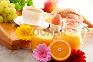 Breakfast on tray served with coffee