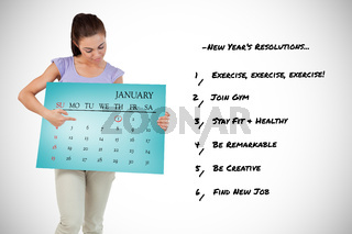 Composite image of young female pointing and looking at calendar