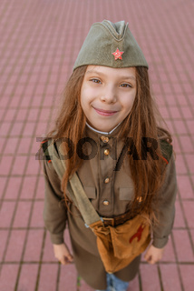 small girl in Soviet military uniforms