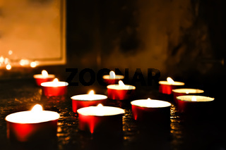 Flashing candles on the floor in a dark place