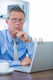 Thoughtful businessman looking at camera