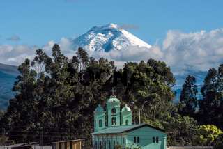 Cotopaxi volcano over the San Jaloma Church and Village, Andes of Ecuador