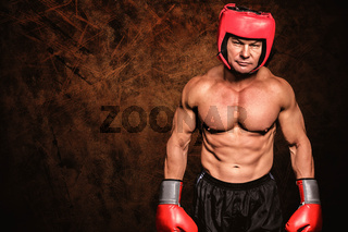 Composite image of portrait of shirtless man with boxing headgear and gloves