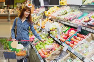 Smiling customer picking apples