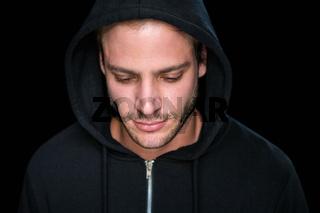 Handsome man wearing a black hoodie