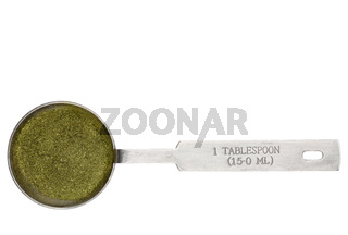 wheatgrass powder in a tablespoon