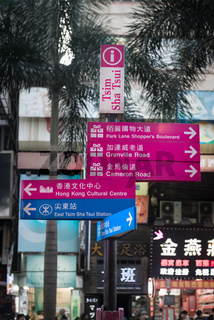 Bold, colorful street signs in English and Chinese languages, Hong Kong