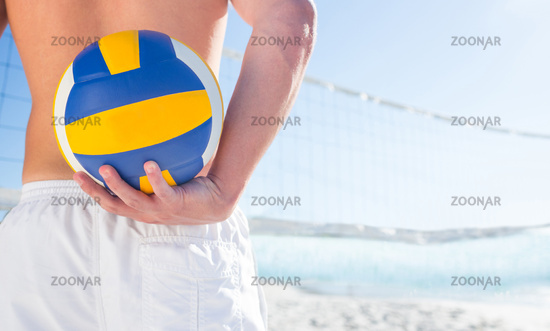 Handsome man holding volleyball