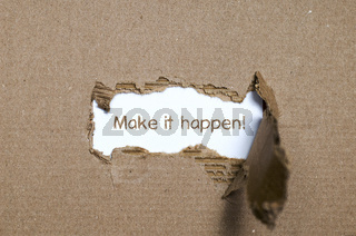 The word make it happen appearing behind torn paper.