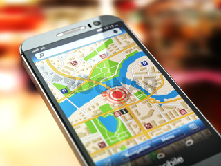 Mobile GPS navigation concept. Smartphone with city map on the screen.