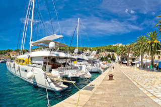 Hvar waterfront sailboat in yachting harbor