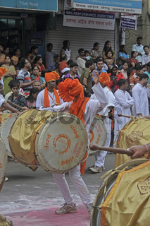 playing musical instrument called 'dhol-taasha'