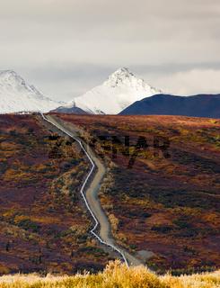 Oil Transport Alaska Pipeline Cuts Across Rugged Mountain Landscape
