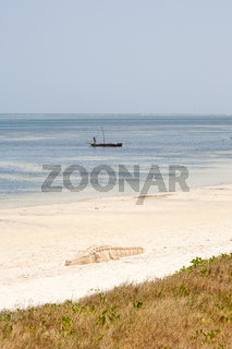 Old wooden arabian dhow in the ocean