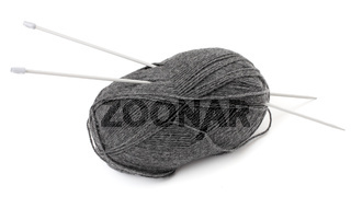 Ball of wool and knitting needles, white background
