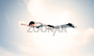 Business man flying like a superhero in clouds on the sky