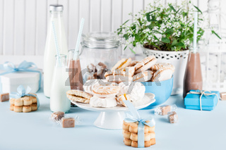 Baby shower in blue with sweets and milkshakes
