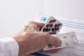 Doctor prescribing drugs elevated view
