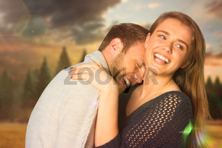 Composite image of close up of happy young couple