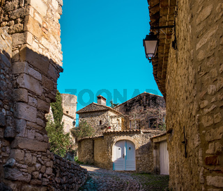Empty street of La Roque-sur-Cèze, it is very picturesque village on a rocky peak in southern France. This place classified as one of the most beautiful villages in France
