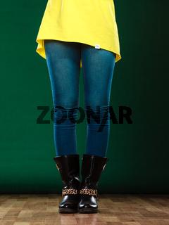 woman legs in denim trousers boots
