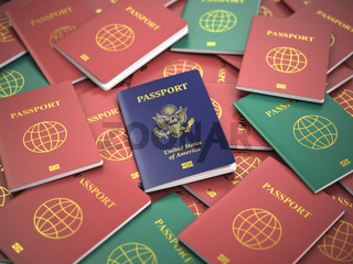 Passport of USA on the pile of different passports. Immigration concept. USA passports.