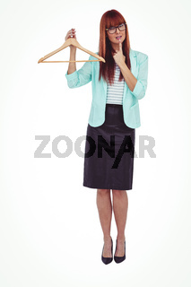 Hipster woman holding clothes hanger