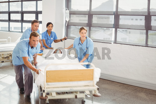 Group of doctors carrying woman patient