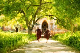 Young Buddhist novice monks running
